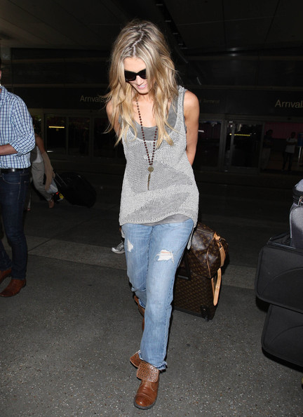 Delta Goodrem was spotted at LAX looking laid-back in ripped jeans.