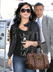 Demi Lovato looked sporty in her Carrera shield sunglasses while catching a flight.