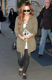 Demi Lovato kept casual in an olive cargo jacket and skinny jeans.