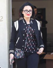 Demi Lovato was spotted out in West Hollywood looking sporty in a black-and-white varsity jacket by Saint Laurent.