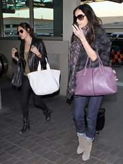 Demi Moore strolled through LAX in taupe suede mid-calf boots.