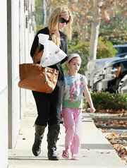 "Denise totes around her pricey all purpose ""Birkin"" bag while picking up her daughters from gymnastics."
