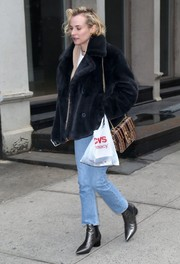 Diane Kruger balanced out her lavish top with casual jeans.