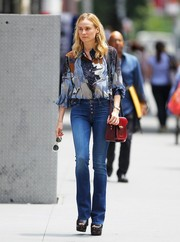 Diane Kruger teamed her jeans with a stylish print blouse.