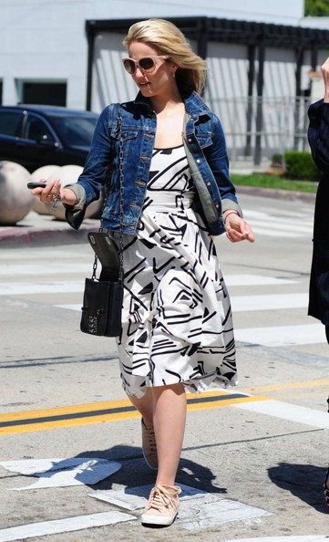 Dianna Agron opted for nude canvas sneakers to pair with her dress.