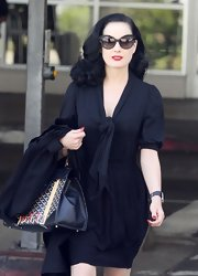 Seen arriving at LAX, Dita Von Teese was looking perfectly put together with smooth, bouncy curls.