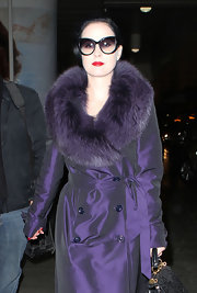 Dita Von Teese looked glamorous in black cat eye sunglasses. Only Dita can get away with wearing her sunglasses at night.