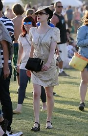 Dita Von Teese showed up at the Cochella festival in a cute leather shoulder bag that went well with her leather sandals.