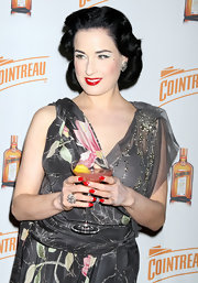 Dita Von Teese posed on the red carpet in a floral dress which she paired with a sparkling cocktail ring.