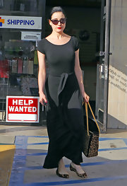 Dita was out and about town in a chic and comfy ensemble. She accessorized the look with an animal print tote and matching flats.