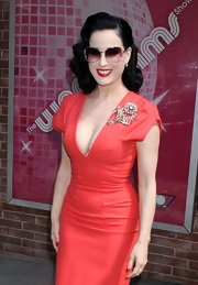 Dita Von Teese showed cased her retro glamour while visiting the 'Wendy Williams Show' with her signature retro waves.