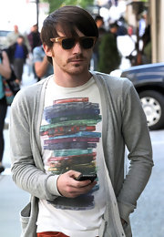 Drake Bell rocked these thick plastic shades on his day out.