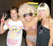 Lady Gaga posed with fans in shield sunglasses after preforming on stage.