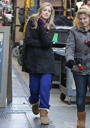 Ella bundled up in blue sweatpants and tan sheepskin boots.