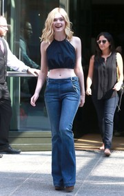 Elle Fanning showed off her belly button in a navy halter crop-top while out and about in New York City.