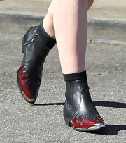 Elle Fanning was on fire in these sleek flame-detail leather ankle boots.
