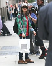 Ellen stuck to a cool green and red plaid shirt for her hipster look while out in NYC!