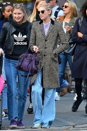 Underneath her coat, Elsa Hosk was retro in a pair of flare jeans.