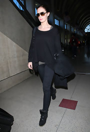 Emily Blunt kept things refreshingly simple at the airport in black skinny jeans and a matching sweater.