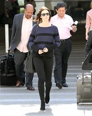 Emily Blunt chose a navy and black striped sweater for her classic and preppy daytime look.