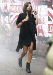 Emily Ratajkowski was fall-chic in a black coat layered over an LBD while doing a photoshoot for DKNY.