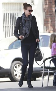Emily VanCamp spored a gray and black patterned scarf for an added touch of texture to her daytime look.