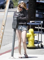 Emma Roberts was spotted wearing Neo Sense sandals in silver.