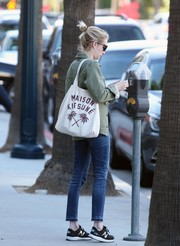 Emma Roberts ran errands in West Hollywood carrying a Maison Kitsune palm tree-print tote.