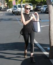 Emma Roberts dressed down in a plain black tank top for a day of shopping.