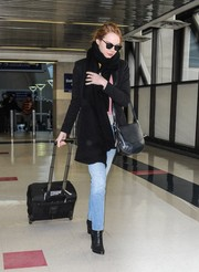 Emma Stone sealed off her airport look with simple black ankle boots.