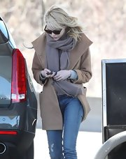 Emma Stone sported a cool, camel-colored wool coat for her look while filling up her car at a gas station in Boston.