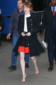 Emma Stone looked darling in a black toggle coat with a flared hem as she arrived for 'Good Morning America.'
