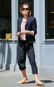Emma Watson finished off her funky ensemble with a pair of nude oxfords by Chloe.