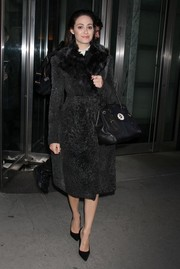 Emmy Rossum looked ultra glam on the streets of NYC in a black fur coat.