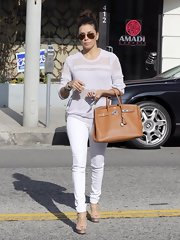 Eva Longoria's brown leather tote was a classic-looking tote with buckle detailing.