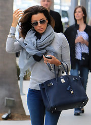 Eva Longoria kept things simple in Beverly Hills wearing a soft gray knit top and a pale blue scarf.
