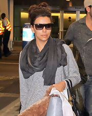 Eva Longoria wore a smoky silk scarf to Miami.