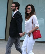 Eva Longoria took a stroll in Hollywood carrying an ultra-chic red Chanel bag.
