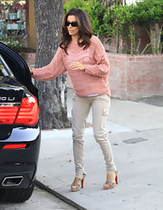 Eva Longoria looked California chic in skinny cargo pants and a loose knit sweater.