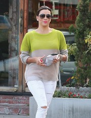 Eva Longoria visited the salon wearing cool black aviators.
