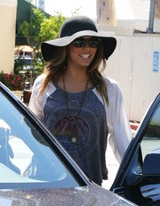 Eva Longoria kept the rays out with a floppy black sun hat while out and about in West Hollywood.