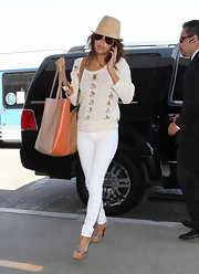 Eva Longoria never strayed from her neutral look when she arrived at LAX carrying a Yosi Samra nude and tangerine Ezra Tote.