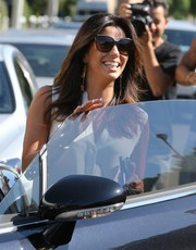 Eva Longoria looked chic in her oversized sunnies while greeting the paparazzi outside the Ken Paves salon.