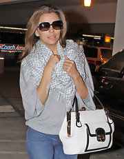 Eva Longoria wrapped up in a posh gray-and-white houndstooth scarf at LAX.