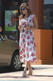 Eva Mendes was out and about with her trusty Starbucks wearing a feminine floral sundress.