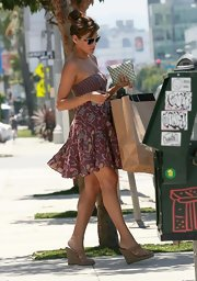 Eva enjoyed the sunny So-Cal weather in a strapless sundress and slip-on wedge sandals.