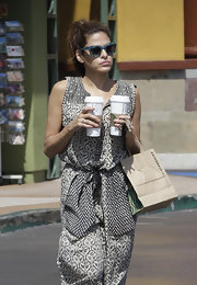 Eva Mendes shielded her eyes from the sun on a Starbucks coffee run wearing a chic pair of blue butterfly shades.