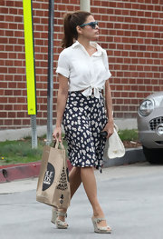 Eva Mendes made a Whole Foods run in LA wearing a cool knee length black skirt studded with daisies.