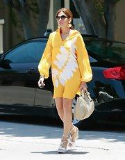 Eva Mendes stepped out in LA wearing a hot yellow day dress. The actress was channeling the late '60s in the long sleeve mod dress with a graphic white leaf print and matching wedges. Talk about street style!