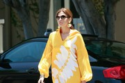 Actress Eva Mendes is spotted out in Los Angeles wearing a very bright and striking caftan.